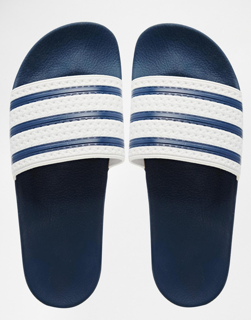 buy popular 1dfb9 6a5b4 ciabatte da piscina adidas