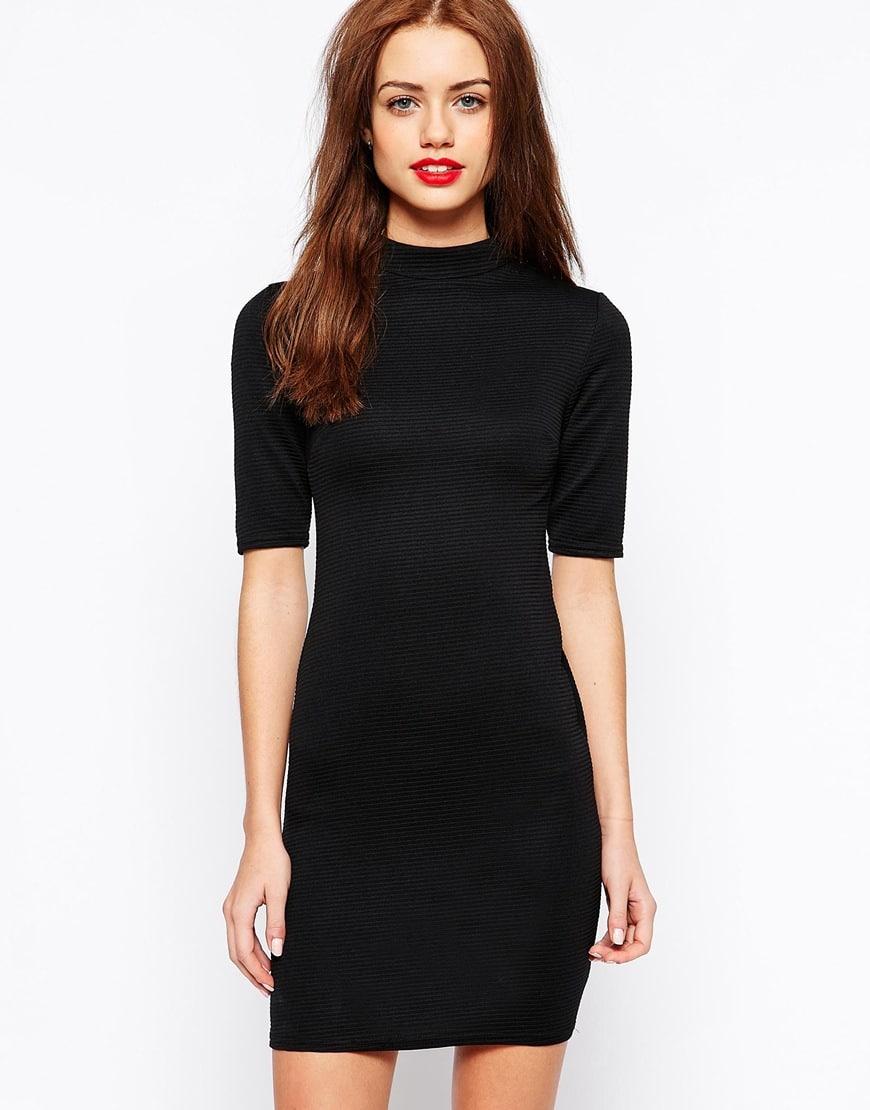 16_Vestito aderente in tessuto elasticizzato e contenitivo, con lavorazione a coste e collo alto a imbuto. New Look (27,99 € su Asos)