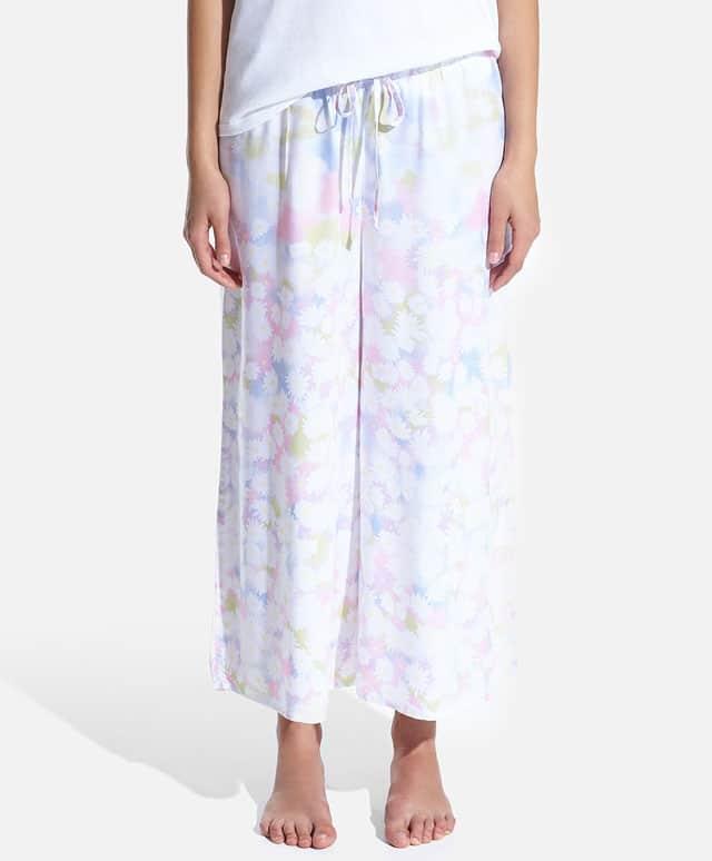 Pantaloni con stampa floreale a margherite. Prezzo 9,99 €