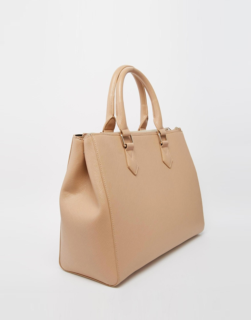 106_Maxi borsa Asos, con zip sul davanti. In pelle sintetica zigrinata (34,99 € su Asos)