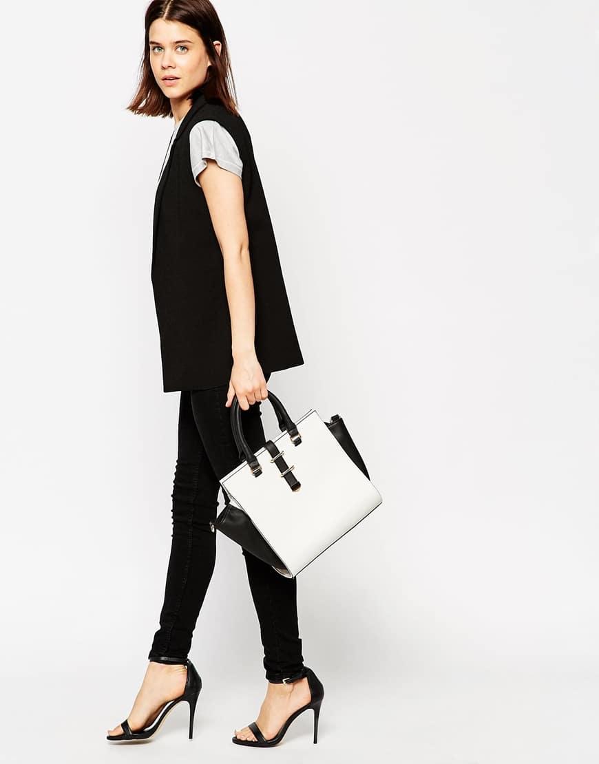 109_Borsa Asos, modello Shopping. Design bicolore e lati ad aletta. In pelle sintetica (48,99 € su Asos)