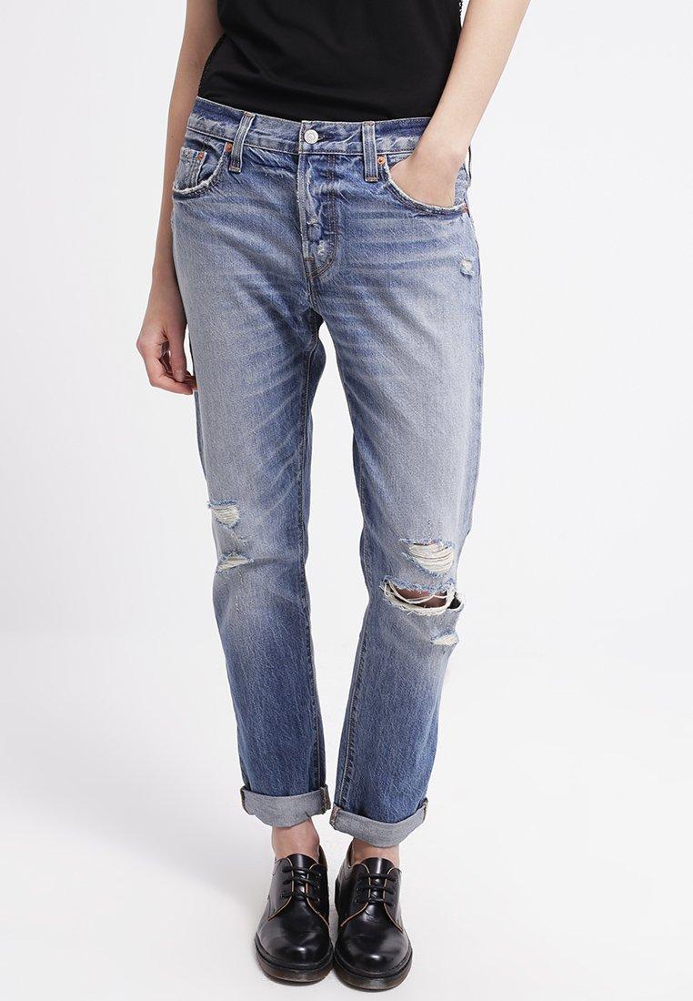 13_jeans strappati donna