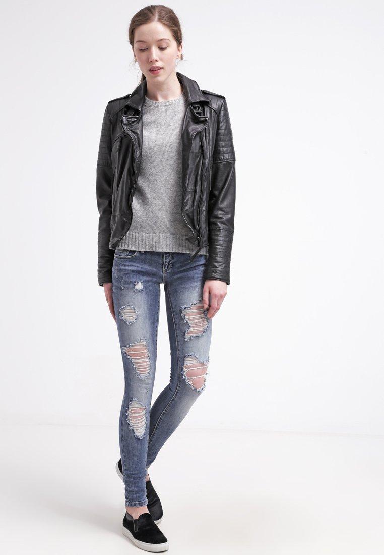 14_jeans strappati donna