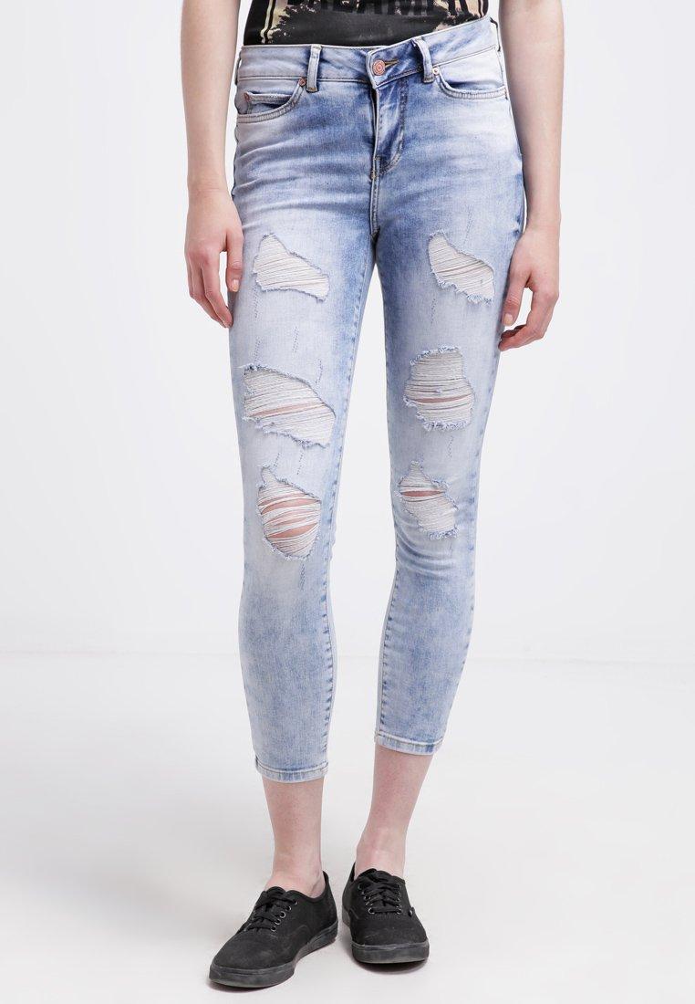 15_jeans strappati donna