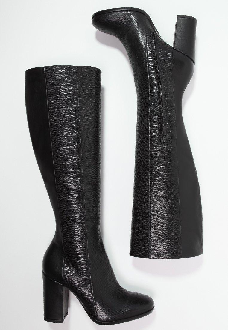 Stivali da donna 30 modelli con tacco grosso di for Interno coscia grosso