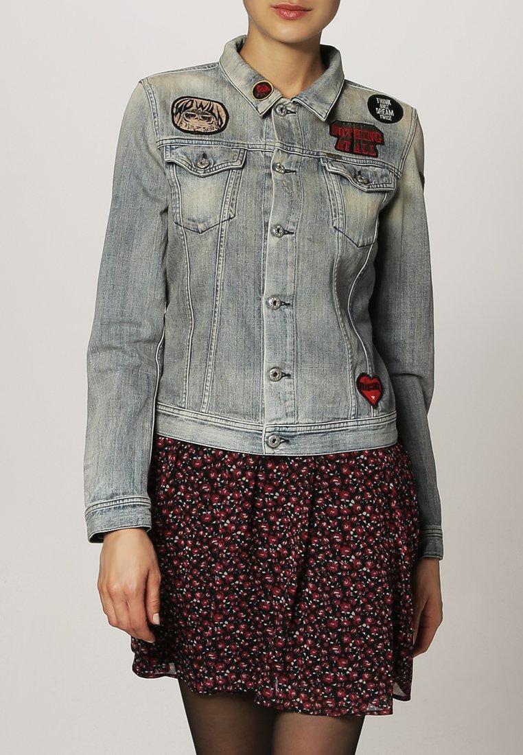 9_Giacca di jeans Diesel, modello corto con toppe applicate (230 € su Zalando)