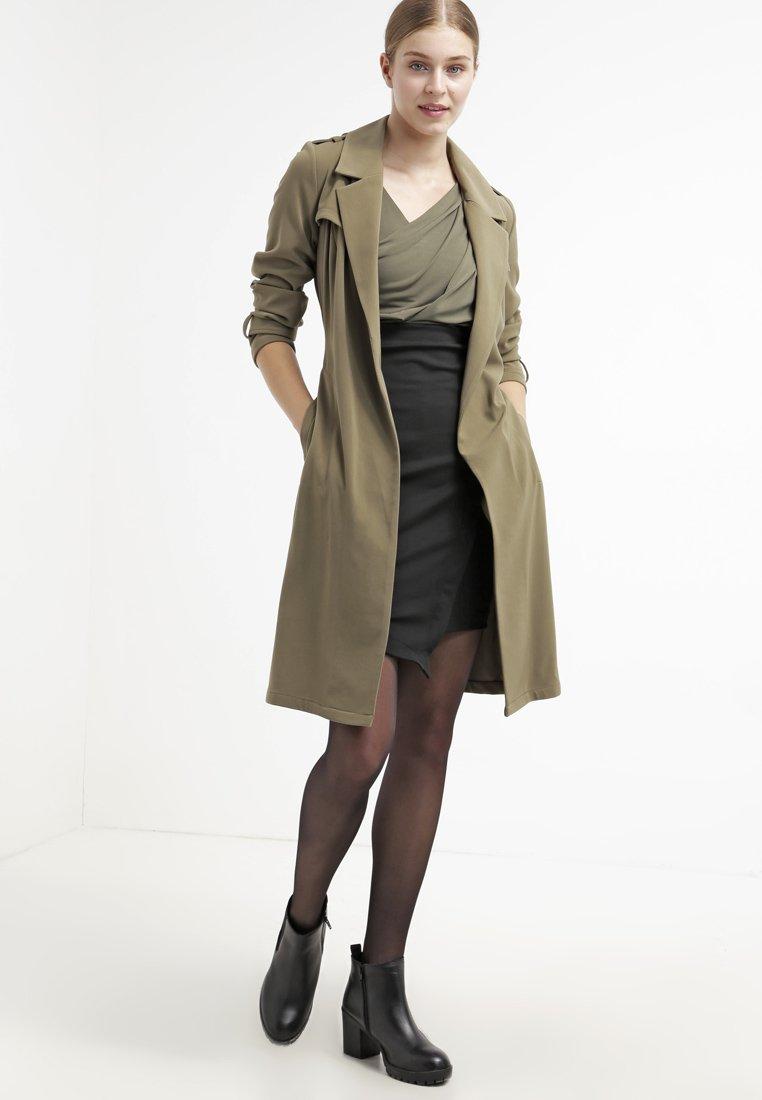 trench coat guida all'acquisto