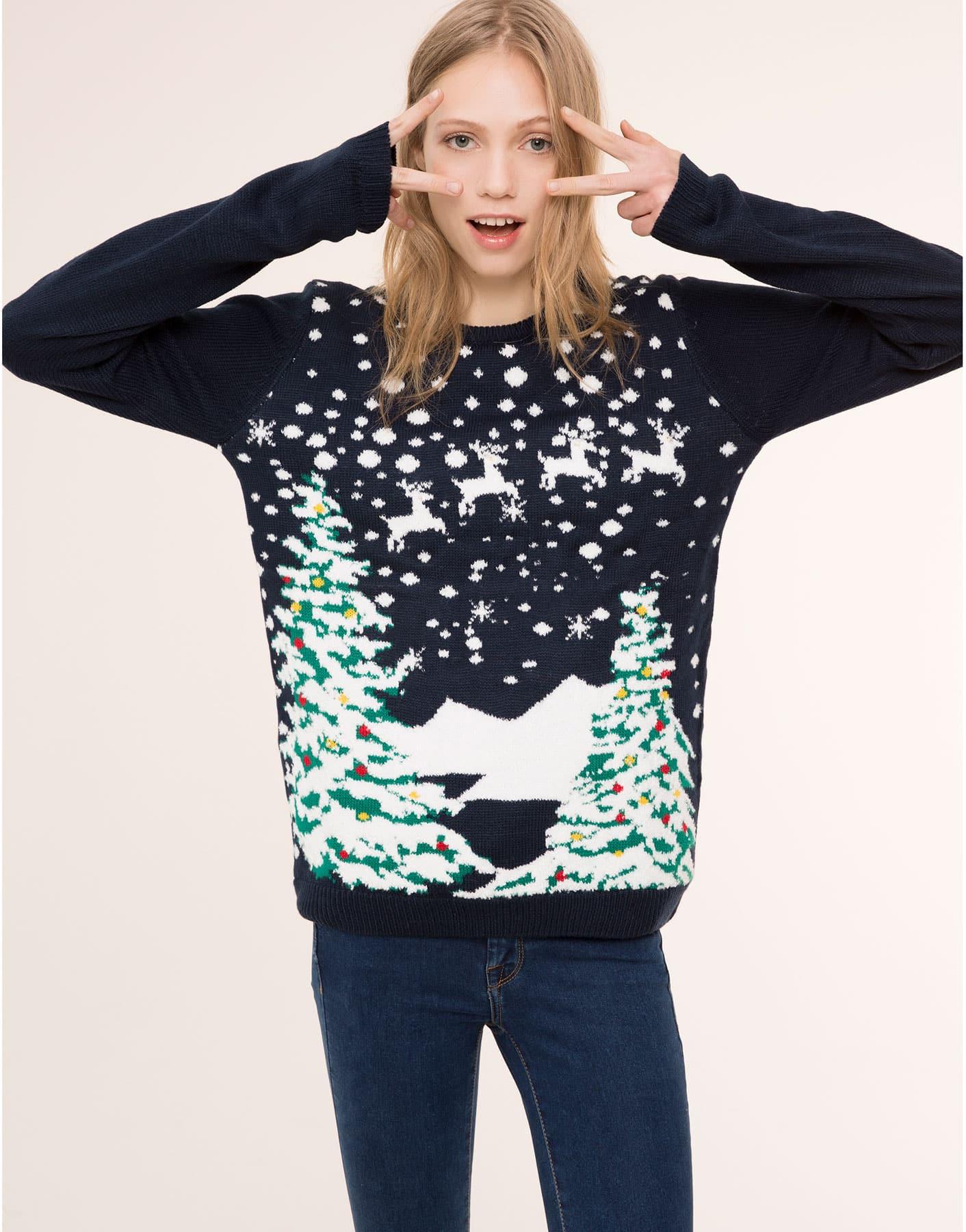 Maglione natalizio blu con paesaggio