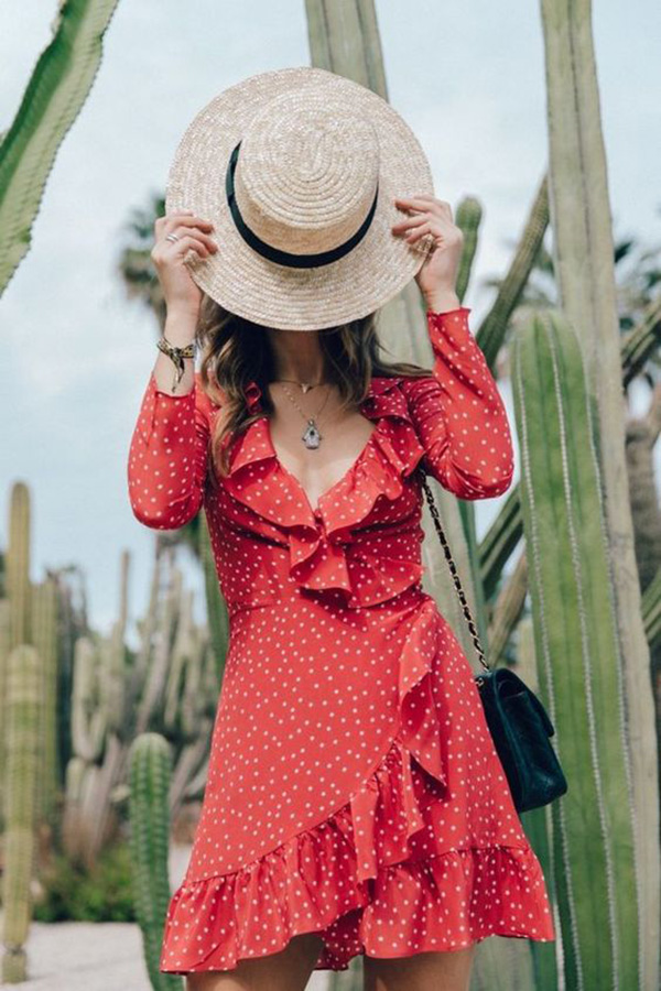 Vestito rosso incrociato con micro pois