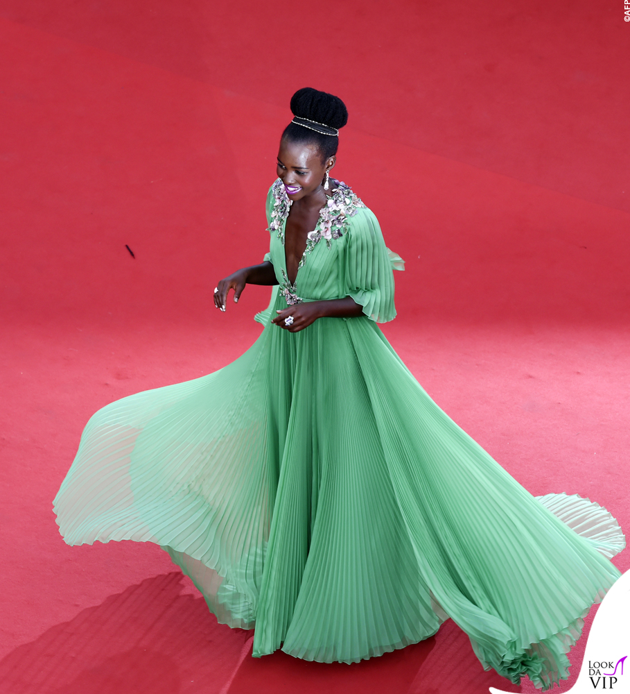 Mexican-Kenyan actress Lupita Nyong'o poses as she arrives for the opening ceremony of the 68th Cannes Film Festival in Cannes, southeastern France, on May 13, 2015.     AFP PHOTO / LOIC VENANCE